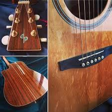 SIMON ET PATRICK GUITARE ACOUSTIQUE PAN COUPE FAITE MAIN LUTHIER CANADIEN SERIE SHOWCASE NATURELLE LUSTREE. TABLE EPICEA MASSIF. MANCHE ACAJOU. FOND ECLISSES TOUCHE & CHEVALET PALISSANDRE. MECANIQUE BAIN D'HUILE OR.